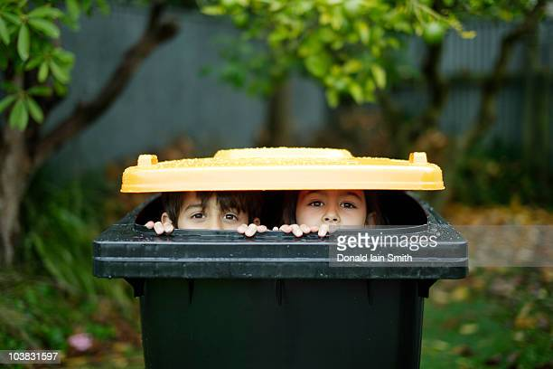 hiding - rubbish bin stock pictures, royalty-free photos & images