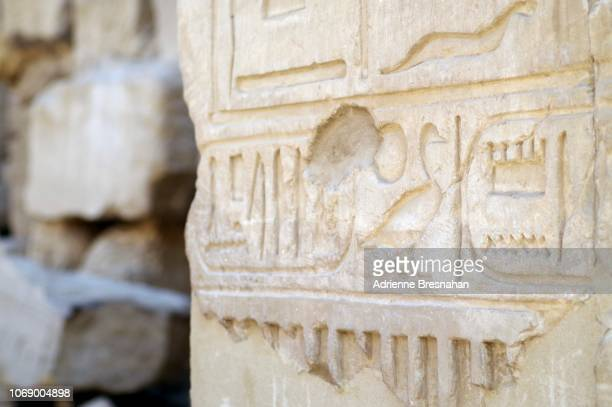 hieroglyphics detail at temple of karnak - hieroglyphics stock pictures, royalty-free photos & images