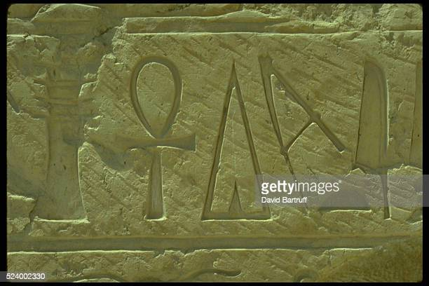 Hieroglyphs including a ankh symbol on the Mortuary Temple of Queen Hatshepsut also known as Deir elBahri in Luxor Egypt
