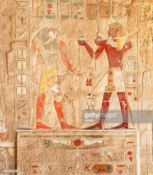 hieroglyphs on an egyptian funerary stela of hatshepsut temple - egyptian god stock pictures, royalty-free photos & images