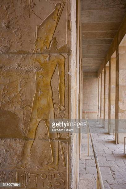 Hieroglyphs on columns at the deserted ancient Egyptian Temple of Hatshepsut near the Valley of the Kings Luxor Nile Valley Egypt According to the...