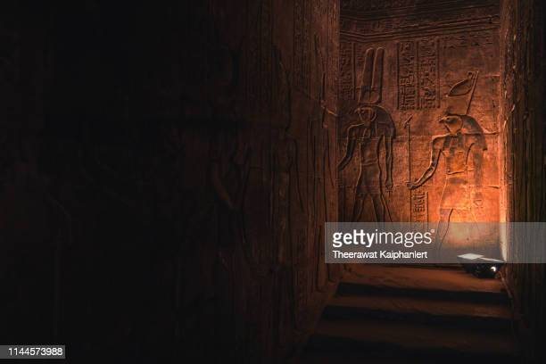 hieroglyphs on the walls of the temple of horus in edfu, egypt - egyptian artifacts stock pictures, royalty-free photos & images