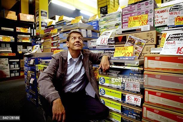 Hi-Fi CEO Richard Uechtritz with stock boxesinside JB Hi-Fi's Elizabeth St store in Melbourne, 18 September 2003. The AGE Picture by ANDREW DE LA RUE