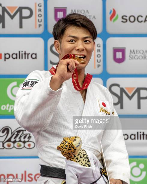 Hifume Abe of Japan proudly shows his second u66kg world gold medal during day two of the 2018 World Judo Championships at the National Gymnastics...