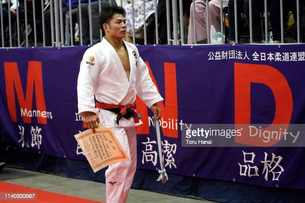 Hifumi Abe holding his silver medal leaves after being defeated by Joshiro Maruyama in the Men's 66kg final match during day two of the All Japan...