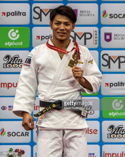 Hifumi Abe of Japan at the age of 21 proudly shows his second world championships gold medal while standing on the podium during day two of the 2018...