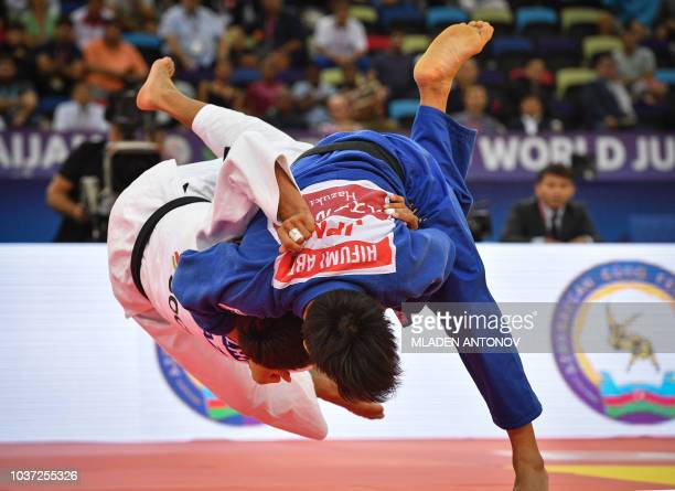 Hifumi Abe of Japan fights for the gold medal against Yerlan Serikzhanov of Kazakhstan in the under 66kg men category of the 2018 Judo World...