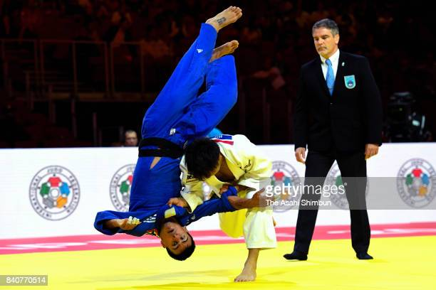 Hifumi Abe of Japan throws Georgii Zantaraia of Ukraine to win in the Men's -66kg quarter final during day two of the World Judo Championships at the...