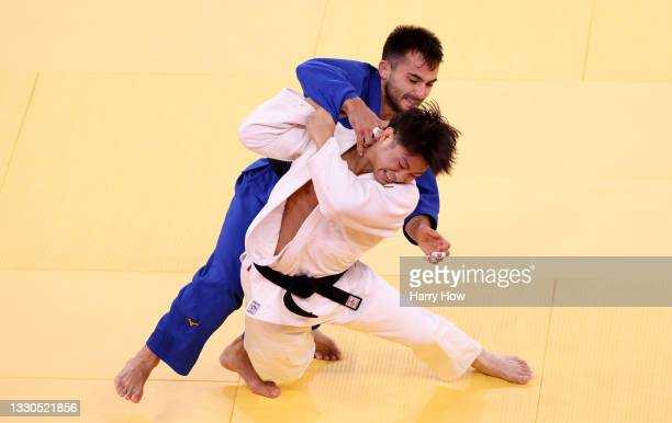 Hifumi Abe of Team Japan and Vazha Margvelashvili of Team Georgia compete during the Men's Judo 66kg Final on day two of the Tokyo 2020 Olympic Games...