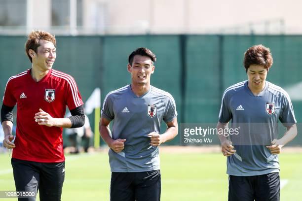 Higashiguchi Masaaki and Makino Tomoaki and Miura Genta run during a Japan training session on January 22 2019 in Sharjah United Arab Emirates