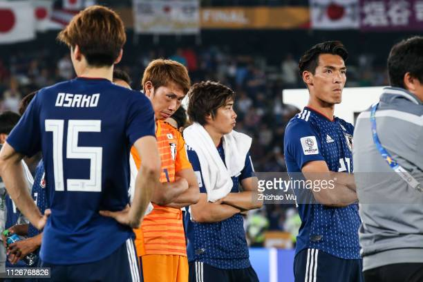 Higashiguchi Masaaki and Makino Tomoaki of Japan show their dejection after the AFC Asian Cup final match between Japan and Qatar at Zayed Sports...