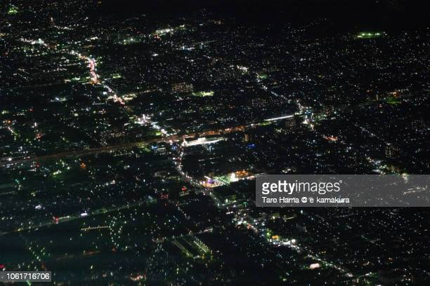 Higashiosaka city in Osaka prefecture in Japan night time aerial view from airplane