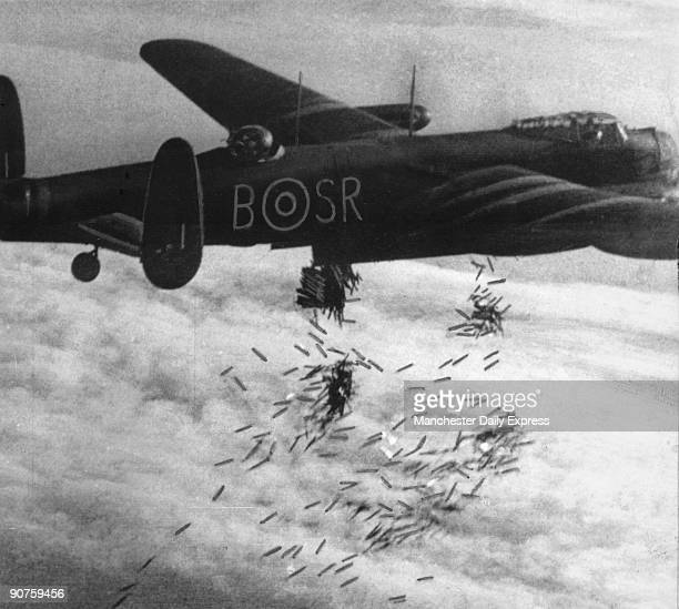 High above Duisburg Germanys greatest inland port until Saturday last and incendiary shower is dropped from the bombbay of a Lancaster This is one...