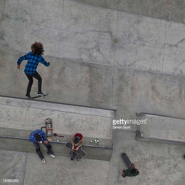 High above the Venice skate park we witness an unusual moment a boy in checkered flight while his friends are oblivious to his performance The...