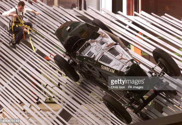 High access worker Marcus Raven installs the first cars in the new Motorsport Gallery at the National Motor Museum in Beaulieu The New Forest * The...