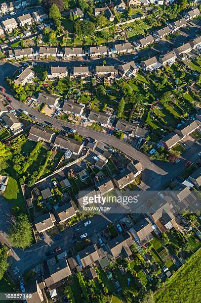 high aerial view over suburban streets homes green gardens - overhemd en stropdas stock pictures, royalty-free photos & images