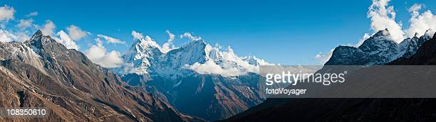 High altitude remote wilderness panorama snow mountain peaks Himalayas Nepal