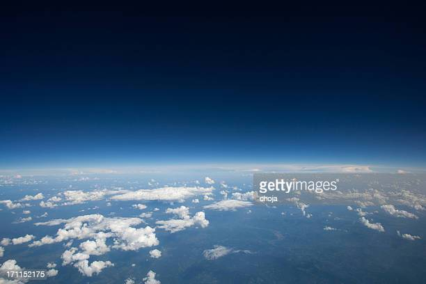 high altitude view of slight curvature to the earth... - atmosphere stock pictures, royalty-free photos & images