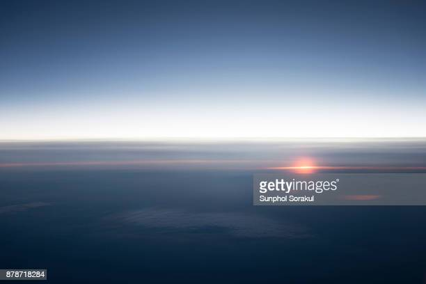 A high altitude view of sun sparkle on the horizon
