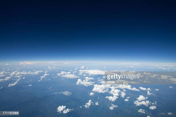 high altitude view of the slight curvature to earth.. - atmosphere stock pictures, royalty-free photos & images