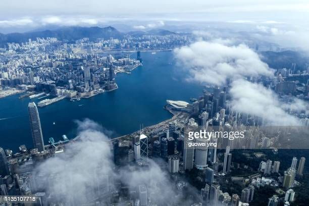 high altitude view of victoria harbour, hong kong - hong kong fotografías e imágenes de stock