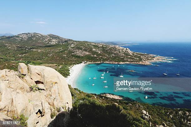 high angel view of sailboats anchored in sea against sky - corsica stock photos and pictures