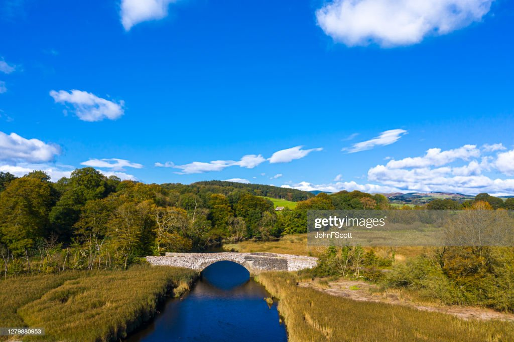 High angle aerial view of an old stone bridge in Dumfries and Galloway south west Scotland : Stock Photo