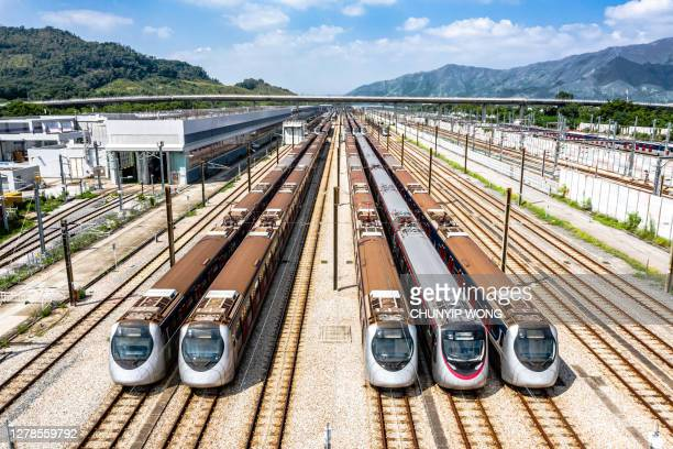 high angle aerial view of mtr pat heung maintenance centre depot with train lines - rail transportation stock pictures, royalty-free photos & images
