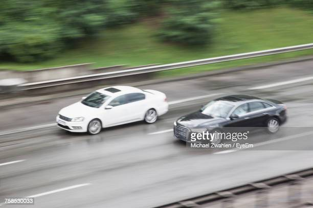 High Angle Blurred Motion Of Cars Moving On Highway During Monsoon