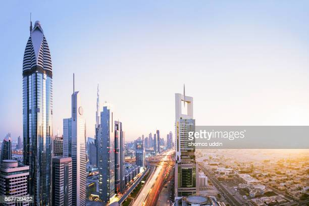 high angle cityscape of dubai skyline - digital composite - downtown district stock pictures, royalty-free photos & images