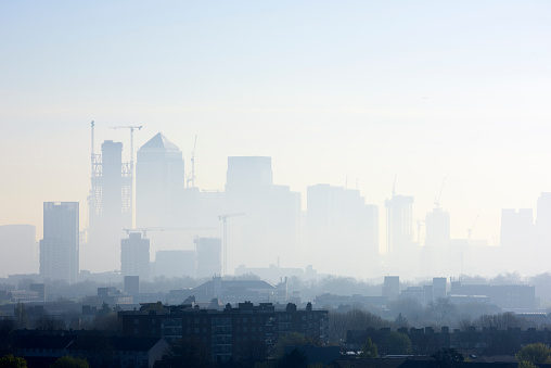 High angle cityscape of London skyline shrouded in smog - gettyimageskorea