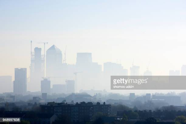 high angle cityscape of london skyline shrouded in smog - smog stock pictures, royalty-free photos & images