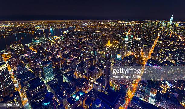 High angle cityscape of Manhattan financial district and One World Trade Centre at night, New York, USA