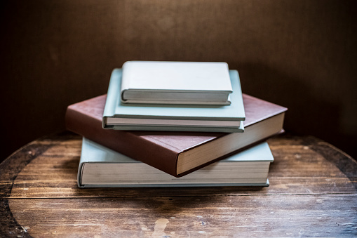 High angle close up of stack of book s on wooden table. - gettyimageskorea