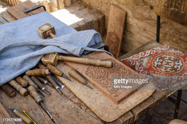high angle close up of traditional woodworking tools, khiva, uzbekistan. - muziek stock pictures, royalty-free photos & images