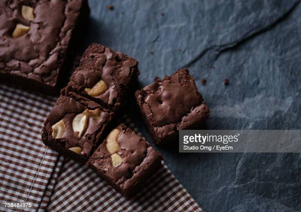 high angle close-up of brownies with napkin on slate - brownie stock pictures, royalty-free photos & images