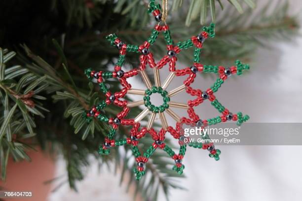 High Angle Close-Up Of Decoration Hanging On Christmas Tree