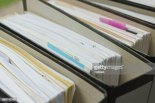 High angle close-up of ring binders in creative office