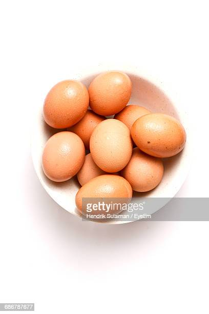 high angle close-up view of eggs in a white bowl - animal egg stock pictures, royalty-free photos & images