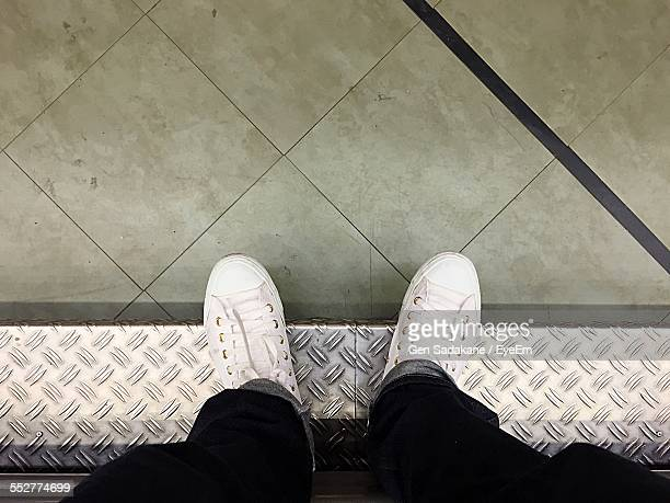 High Angle Low Section Of Man Standing On Floor
