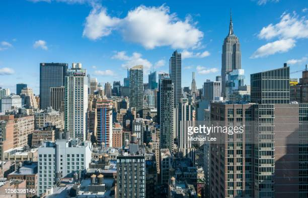high angle midtown manhattan skyline - new york - new york state stock pictures, royalty-free photos & images