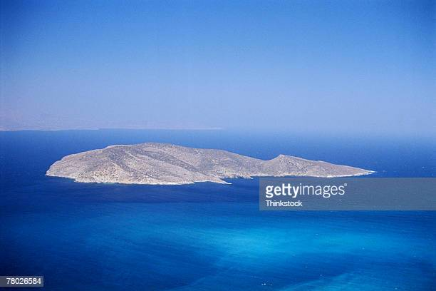 high angle of blue waters and greek island with blue sky. - thinkstock stock-fotos und bilder