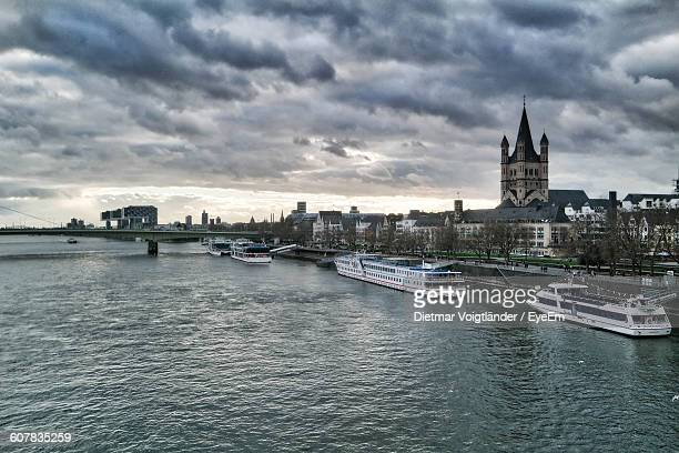 High Angle Of Cruise Ships On River By City Against Cloudy Sky