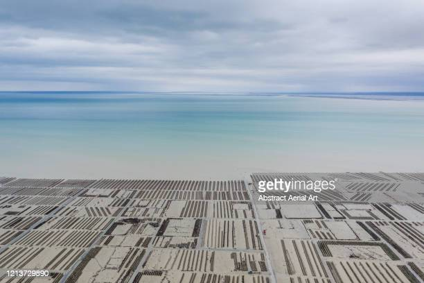 high angle perspective looking across awe inspiring oyster farm, france - ille et vilaine stock pictures, royalty-free photos & images