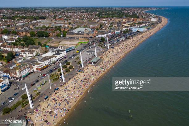 high angle perspective of a busy southend beach during covid-19 pandemic, southend-on-sea, essex, united kingdom - heatwave stock pictures, royalty-free photos & images