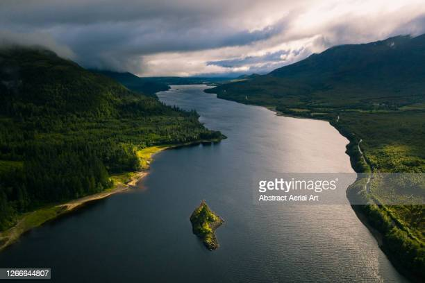 high angle perspective showing an island in a loch, scottish highlands, united kingdom - mountain stock pictures, royalty-free photos & images