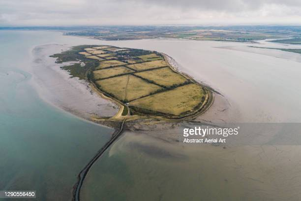 high angle perspective showing osea island, england, united kingdom - island stock pictures, royalty-free photos & images