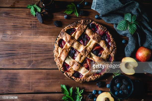 high angle photograph of a lattice fruit pie - sweet pie stock pictures, royalty-free photos & images