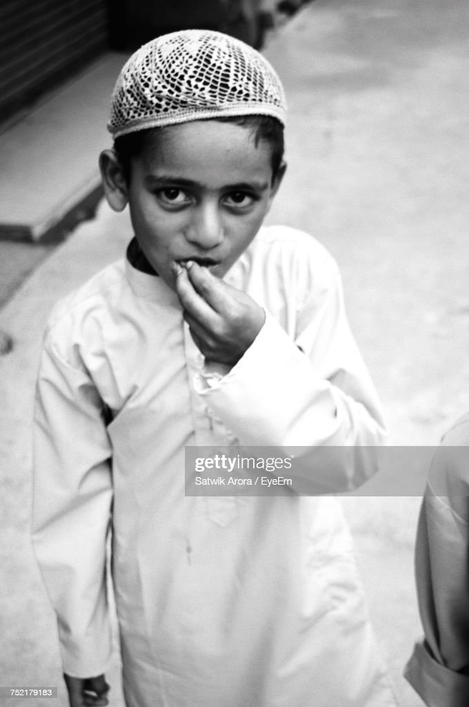High Angle Portrait Of Boy Wearing Traditional Clothing Standing On Street