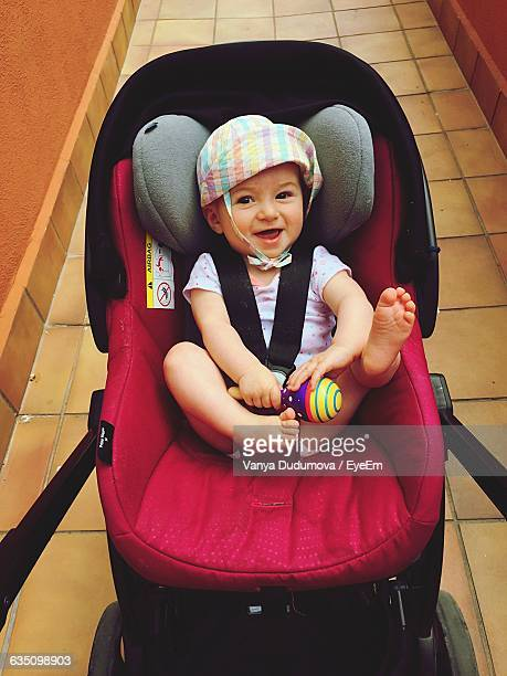 High Angle Portrait Of Cheerful Baby In Carriage